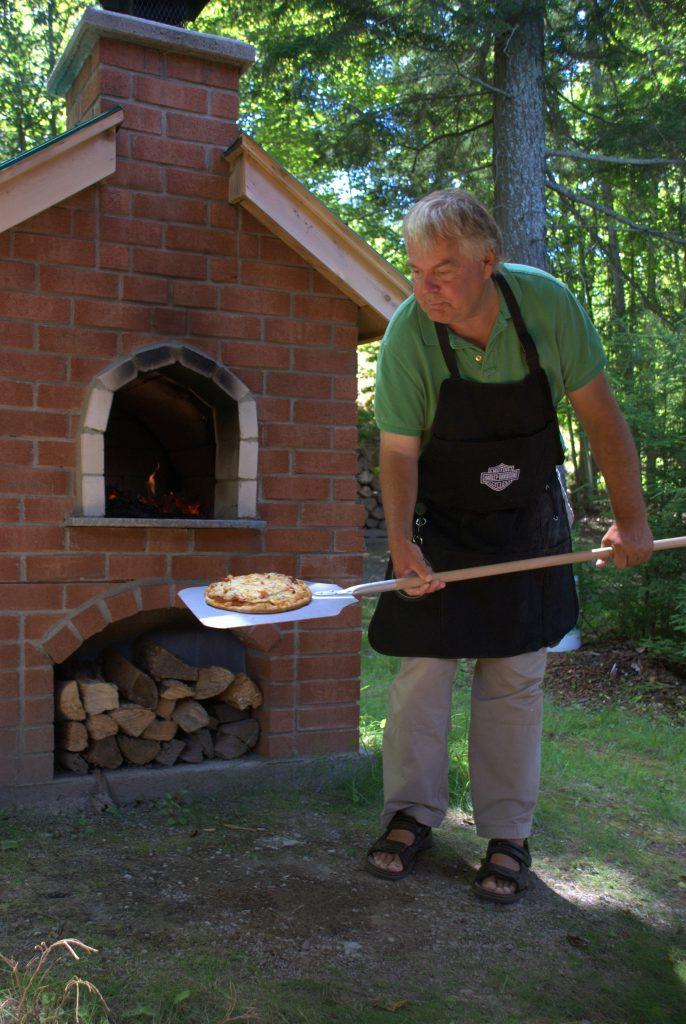 Konrad baking Pizza - Bearskin Lodge